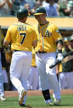 OAKLAND, CA - JULY 18: Brandon Inge #7 of the Oakland Athletics is congratulated by teammate Cliff Pennington #2 after Inge hit a solo home run in the fifth inning against the Texas Rangers at O.co Coliseum on July 18, 2012 in Oakland, California. (Photo by Thearon W. Henderson/Getty Images)