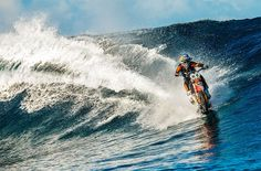 motorcross athlete robbie maddison rides waves with his dirt bike