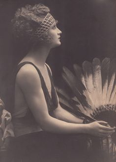 1920s? Gorgeous evening bandeau? Feather fan? #ChicagoStyle