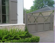 Sally Wheat, boxwoods, foxtail ferns, gray shutters and fence