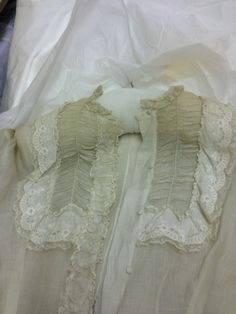 Scoop neck gathered detail edged with lace and broderie anglaise