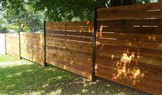 Horizontal Style Fence With Black Posts Stained Wood Fence Fence Design Modern Fence Design