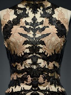 Alexander Mcqueen (British, founded 1992), Sarah Burton (British, born 1974). Dress (detail), spring/summer 2012, Prêt–à–Porter. Machine– and hand–sewn nude silk lace bonded with laser–cut black patent leather, hand–sewn godets of nude silk tulle, hand–appliqued with nude silk lace motifs. Photo © Nicholas Alan Cope. #ManusxMachina #CostumeInstitute