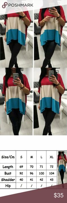Loose Short Sleeve Shirt Red Cream & Blue Striped Top. Solid Red in the Back.  Slightly Hi-Lo.  This is NWOT Retail Price Firm Unless Bundled.  Approximate Measurements in 3rd Picture. Tops Tunics