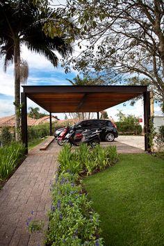 Garajes de estilo clásico por M.Lisboa Arquitetura e Interiores