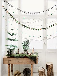 Méchant Design: natural & raw Christmas would love this at christmas  time make out of vintage fabric in fron of the big windows.