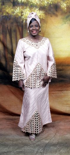This is a lovely African outfit. Made of 100% cotton brocade. Lined. Dry clean. Made in Ghana, West Africa.
