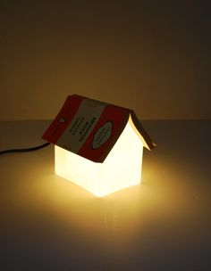 It is not CMYK- but it is my  belief that no modern nursery would be complete without it.  Oeuf Lamp.