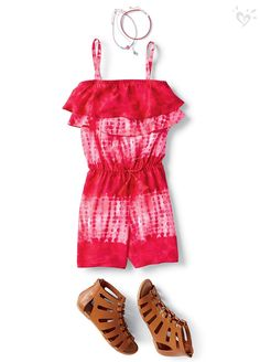 Ruffles add the right amount of ounce to her fave romper.