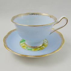 Made by Royal Albert, tea cup and saucer are blue with yellow flowers in the center and gold trimming. Excellent condition (see photos). Markings read: Royal Albert Crown China England Please bear in mind that these are vintage items and there may be small imperfections from age or