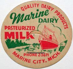 Vintage milk bottle cap MARINE DAIRY ship pictured Marine City Michigan n-mint+