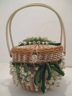 1950's Lily of the Valley posy basket vintage bag.  Fifties fantasy of wickerwork woven with plastic strips in a circular basket shape with lid.