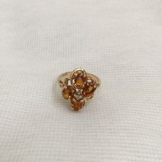 14K Golden Citrine Ring w/ 2 Small Diamonds sz 6.5 Beautiful 14K Golden Citrine ring with 4 citrine stones and 2 small diamonds. Setting is flower or four leaf clover shaped.  Size 6.5, stamped 14K Jewelry Rings