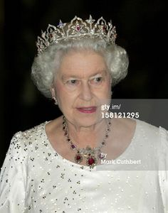 After the death of her mother in 2002, the Oriental Circlet was worn by Queen Elizabeth II. In it's changed form it has eleven intricate diamond arches, each containing a five-petaled diamond flower with central ruby, with floral diamond spacers, on an open-work foliate band, rising from a band of diamonds.