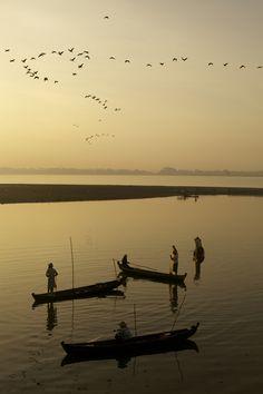 Fishermen at sunrise in Amarapura, Myanmar. Photo taken by Christina Feldt