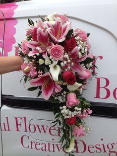 Gorgeous Shower bouquet of stargazer lilies, roses, bouvardia and gypsophila .