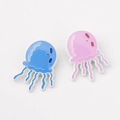 Ahh, another beautiful day in Bikini Bottoms own Jellyfish Fields. An untamed world of natural order where the little jellyfish jellies roam free across the salty seascape.  1 soft enamel pin, epoxy coated. Available in both pink and blue. ***Each pin sold separately***