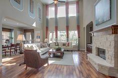 Stunning two-story family room from Newmark Homes in Woodforest!  #NewmarkHomes #LivingRoom #FamilyRoom