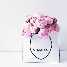 Peonies + Chanel - put a vase in a designer bag and you have instant desk appeal.