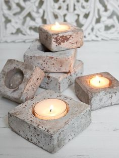 rustic concrete votive holders -- perhaps can be done by sanding after painting? (Diy Candles Making) Concrete Candle Holders, Diy Concrete Planters, Concrete Crafts, Diy Candle Holders, Concrete Projects, Diy Candles, Yankee Candles, Beeswax Candles, Cement Art