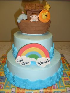 """This cake was made for a little boy's babtism.  The little boy is """"in"""" the ark.  The ark is rkt covered in fondant.  All figures are fondant as well. Thanks for looking!"""