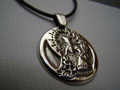 Medalla de la Virgen.