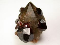 Spessartine garnet crystals on Smoky Quartz from Lechang Mine, China