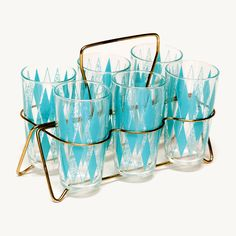 mid-century glass set: Set of 6 high ball glasses in a retro 1950s turquoise pattern. Comes with gold carrier.