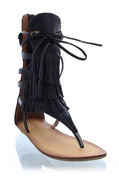 "'Rain Dance' Sandal - Its a suede sandal but its also an open toe calf bootie! This three layered fringe shoe has a 6"" back zip closure with a tie front detail. Easy to wear, this vegan suede sandal is comfy and cute. Get ready to hit an outdoor festival in the heat of the summer and perform a rain dance in these! Available in Black. 0.25"" rubber heel. Cushioned insole. Felted, nonskid rubber sole. All vegan friendly, man made materials. Imported."