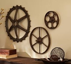 Wall Decor -- Rustic Gears --   Gears in three coordinating shapes are modeled after rustic tractor parts discovered in a country store. They take on a unique, sculptural beauty as wall display.