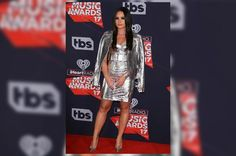 Demi Lovato looked absolutely stunning at the iHeart Radio Music Awards over the weekend. The 'Confident' singer and actress opted for a powerful, sleek retro hairstyle to accompany her metallic mini dress. The whole look came together in a tribute to mod fashion that's anything but shy. Stylist Clyde Haygood took inspiration from her futuristic outfit choice...