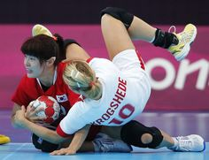 South Korea's Jung Jihae collides with Denmark's Christina Krogshede in their women's handball Preliminaries Group B match at the Copper Box venue during the London 2012 Olympic Games July 30, 2012.