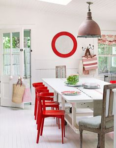 """Red Accents  Because her house in Bridgehampton, New York, """"meanders around corners and up and down steps,"""" design consultant Ellen O'Neill couldn't make sense of the flow. So she painted everything Benjamin Moore's Linen White: """"It's the blank-canvas approach."""""""
