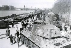 """Captured German equipment on display in Gorky PARK in Moscow in the autumn of 1945. In the foreground German heavy tank Pz.Kpfw VI Ausf.B """"Royal tiger"""" tail number 343, fought in the 505-th heavy tank..."""