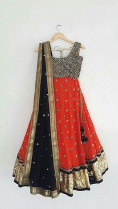 Sleeveless Anarkali with silber work, orange with foral work and black dupatta eith gold border and polka dots.