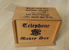Old Telephone money box, Phone from here whenever you will But don't forget who pays the bill - saw these in many friends houses if they had telephones at home.