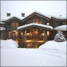 rustic mountain cabin in snow
