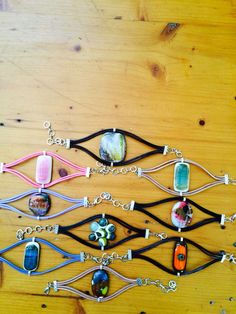 Handmade fused glass bracelets by 8Petals Design - great innovative way to use fused glass in jewelry