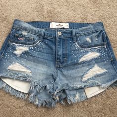 Hollister destroyed rhinestone high waisted shorts Super cute but way too small for me, there are two stains(mud) not really noticeable on pocket that I'm sure will come out I just haven't tried that hard besides just regular washing them. Only worn twice. Hollister Shorts Jean Shorts
