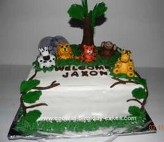 Homemade Baby Shower Jungle Cake: This Baby Shower Jungle Cake is a 10inch square pan stacked. It is covered in homemade buttercream icing. The animals are made out of fondant and the tree