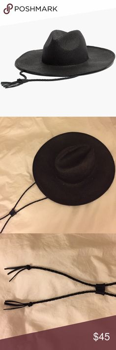 *NWOT MADEWELL WIDE BRIMMED FEDORA W/ LEATHER CORD NWOT MADEWELL WIDE BRIMMED STRAW FEDORA HAT W/ LEATHER CORD. Worn once. A wide-brimmed black straw hat with an adjustable leather chin strap. Wear the braided cord in front or let it trail down your back. Congrats, you just found the coolest way to shade your face from the sun.   Size: M/L Paper straw. Madewell Accessories Hats