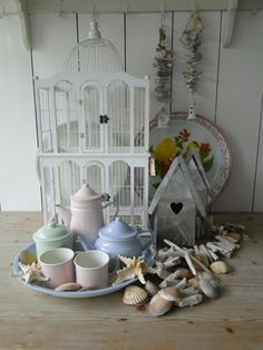 All of my favorite things- tea cups, birdcage & sea shells!