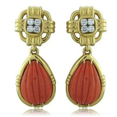 David Webb 18K yellow gold drop earrings featuring carved coral and decorated…