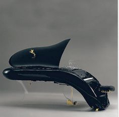 If It's Hip, It's Here: Musical Instruments For Your Eyes: Modern Pianos From Schimmel & Bosendorfer. This one comes with it's own hood ornament!!