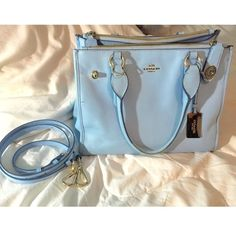 Coach Bag Baby blue authentic Coach satchel bag that has two zipper sides outside the main section, small pockets on the wall of the inside, comes with long strap. Part of the lining came off on the handles where you hold it (see picture), but other than that it's in perfect condition. Don't want it anymore because my ex gave it to me- ladies you know how that goes ha. Coach Bags Satchels