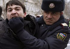 A policeman detains an opposition activist in Baku on March 12. Azerbaijan police detained more than 30 activists of the opposition Musavat Party when its members took to the street to protest against the ruling elite