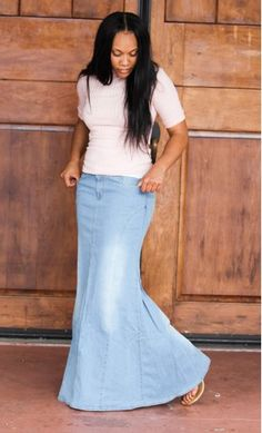 A stone washed light denim skirt with front and back pockets, a mermaid fit and flare style and front zipper available in S-XL