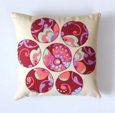A personal favourite from my Etsy shop https://www.etsy.com/uk/listing/457380504/blossom-cushion-handmade-applique