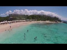 """▶ Aerial AXA... Majestic Meads Bay, Anguila's other """"most famous beach,"""" lined with 5* hotels and where even the beach shacks are awesome.  Watch for the cute little girl waving """"hi."""" Come visit soon! :-)"""