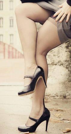 Suggestive street upskirt to show black stockings and black heels.
